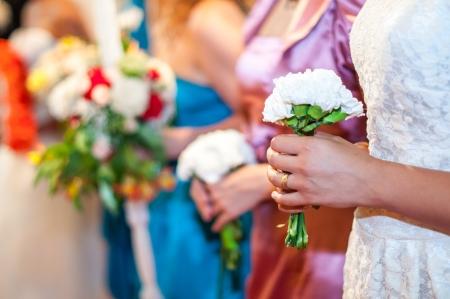 Bridesmaids holding flowers at wedding reception