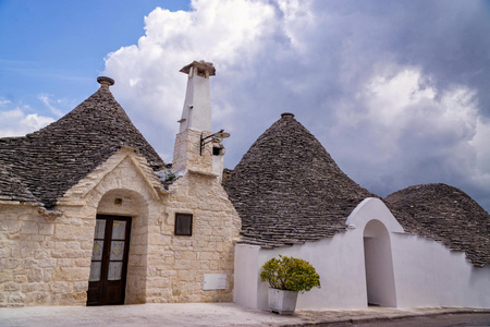 The architecture of Alberobello in southern Italy with its beautiful white houses and conical roofs