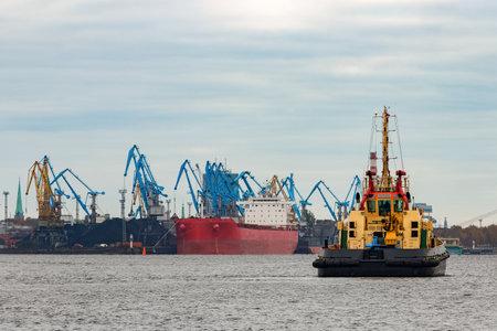 Tug ship in the cargo port of Riga, Europe