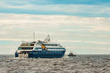 Small blue passenger ship sailing in Baltic sea. Spa services