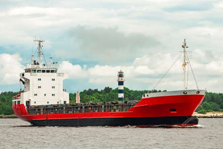 Red new cargo ship moving abroad. Product export in Europe