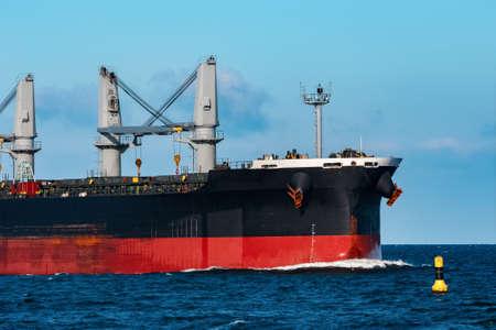 Black bulker ship. Logistics and merchandise transportations