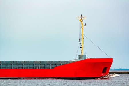 Orange cargo ship. Logistics and merchandise transportations