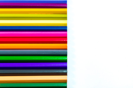 stationery needs: different colored pencils on a white background