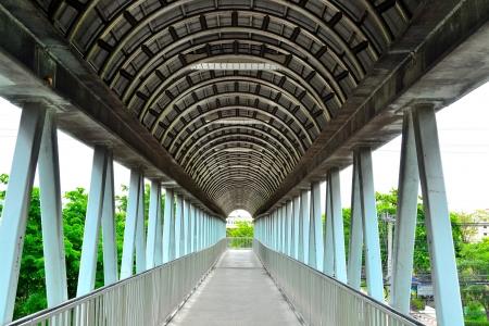 Quite long span man bridge  It cross over railway and roads