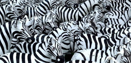 The rows of zebra model  Each comes for one who fulfill their vow, so they bring it and place in front of shrine  This shrine is located in Don Muang International airport  Stock Photo - 16522294