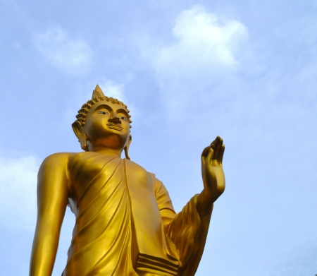Standing Buddha Statue  With some space on top and right margin for adding any suitable text  Stock Photo