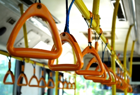 safeguard: When passenger are in the moving bus, they all should hold the rings for their own safety  One who driving business should too as a safeguard