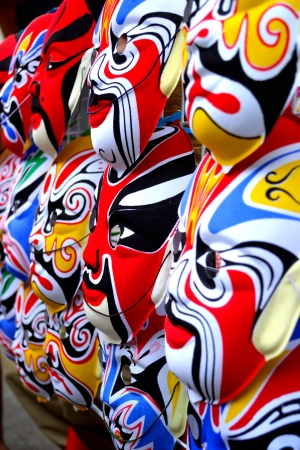 Masks is arranged for sale in front of Chinese shrine during anniversary festival