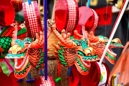 Dragon head chinese-look toys are waiting for children in front of shrine during anniversary of the goddess of mercy