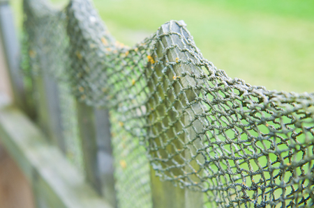 old FishNet on a wood fence for background Stock Photo