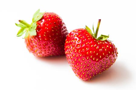 Two fresh strawberry isolated on white background