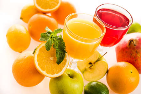 Ripe fruit and juice. Glasses of juice and fruits isolated on white.