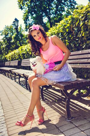 Beautiful girl with a small dog Chihuahua in the park 版權商用圖片