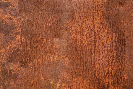 Rusty metal sheet. Brown rusted and scratched metal surface texture or background Reklamní fotografie
