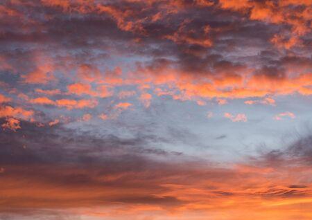 Dramatic sunset pink orange red sky with clouds, bright soft sunrise horizontal background texture Reklamní fotografie