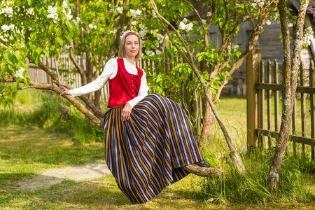 Latvian woman in traditional clothing. Ligo folk.