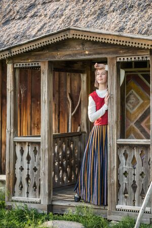 Latvian woman in traditional clothing. Ligo folk. 스톡 콘텐츠