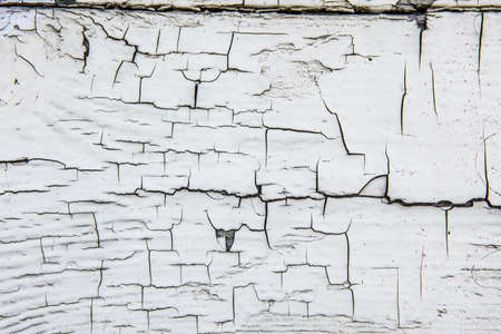 Wooden wall with cracked old white paint. 스톡 콘텐츠
