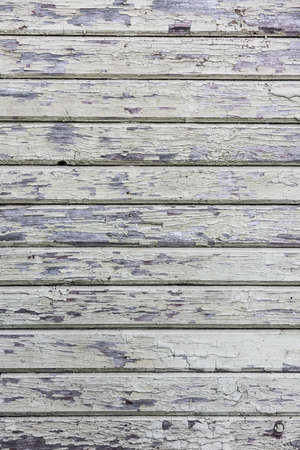 Wooden plank wall with cracked old white paint 스톡 콘텐츠