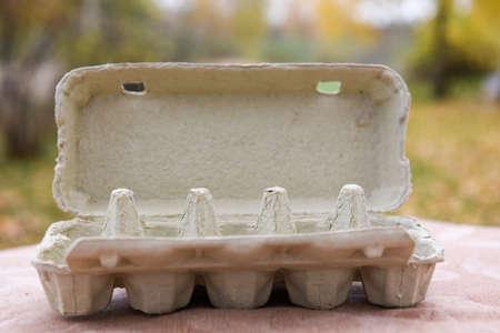 carton empty egg box outside on Easter for design Archivio Fotografico