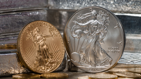 gold silver: American Gold Eagle vs. Silver Eagle Stock Photo