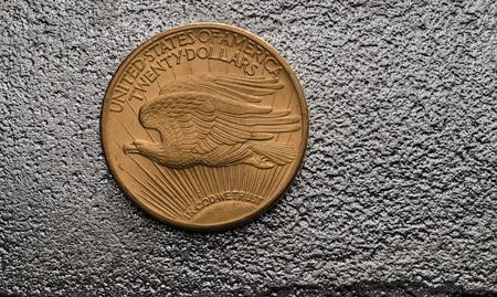 silver bullion: US Gold Coin Saint-Gaudens Double Eagle on SIlver Bar Stock Photo