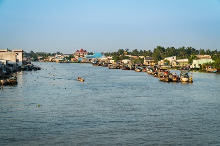 CAI BE - DECEMBER 15, 2017: Heavy loaded boats at traditional floating market on Mekong delta on december 15, 2017 in Cai Be, Vietnam.