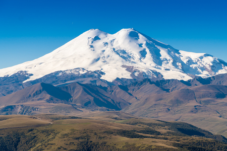 Beautifull landscape view of the mount Elbrus - the highest mountain in Europe. Caucasus mountains at autumn season time.