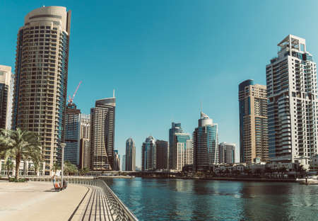 DUBAI, UAE - DECEMBER 12, 2018: Modern buildings in Dubai Marina, Dubai, UAE. In the city of artificial channel length of 3 kilometers along the Persian Gulf. Editöryel