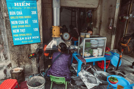 HANOI, VIETNAM - DECEMBER 14, 2018 : Street scene of the Old Quarter of Hanoi. Local daily life of the morning street market, local food restaurant.