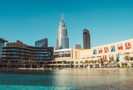 DUBAI, UAE - DECEMBER 12, 2018: View at Burj Khalifa Lake and Modern Dubai Mall in Dubai Downtown, Dubai, UAE. Editöryel