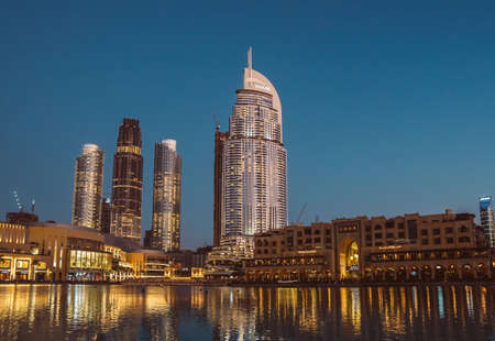 DUBAI, UAE - DECEMBER 12, 2018: Night view at Burj Khalifa Lake and Address Downtown hotel in Dubai Downtown, Dubai, UAE.