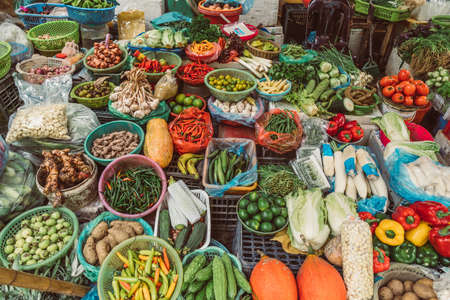 HANOI, VIETNAM - DECEMBER 14, 2018 : Local daily life of the morning street market, street vendors selling various types of fruits and vegetables Editorial