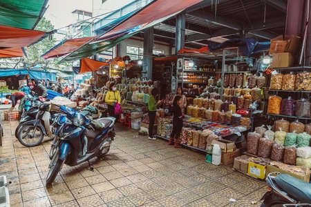 HANOI, VIETNAM - DECEMBER 14, 2018 : Street scene of the Old Quarter of Hanoi. Local daily life of the morning street market, street vendors selling various types of goods.