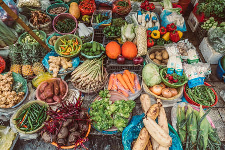 HANOI, VIETNAM - DECEMBER 14, 2018 : Local daily life of the morning street market, street vendors selling various types of fruits and vegetables
