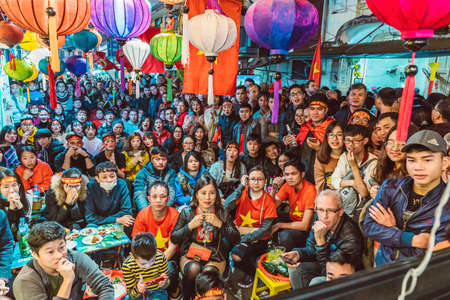 HANOI, VIETNAM - DECEMBER 15, 2018: Thousands of fans flocked to the streets of the capital Hanoi watching game on TV - the ASEAN Football Federation Championship final.