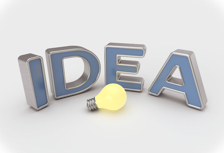Idea concept with blue and metallic text around a lightbulb on white background