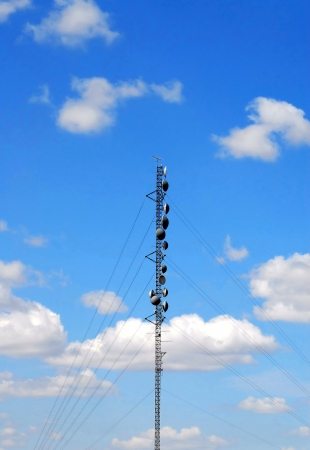 Communications tower on cloudy sky