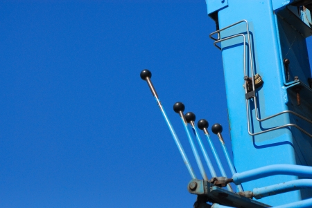 Control levers against clear blue sky.