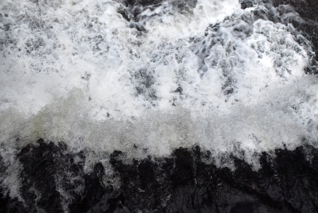 Water churning and foaming on waterfall