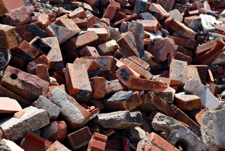 Messy pile of jagged red bricks and debris