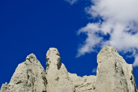 ridgeline: Tops of grey sandstone cliffs against cloud and blue sky Stock Photo