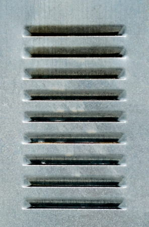 metal grate: Grey metal grate with parallel vents