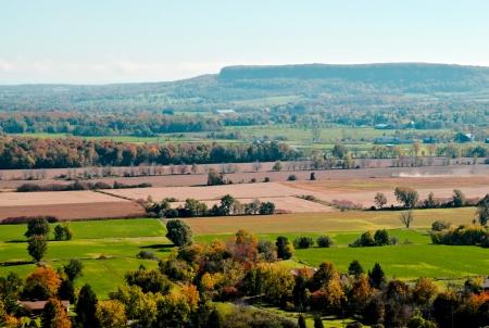 Autumn rural landscape and fields against escarpment in distance