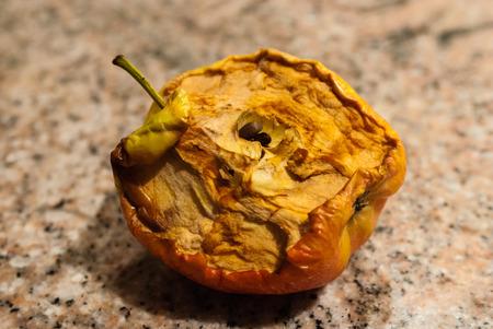 Half-eaten dried apple on granite background  Stock Photo