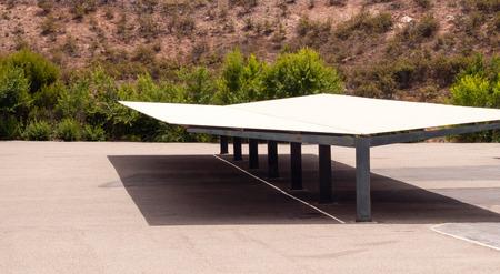 Large empty carport against desert shrubs
