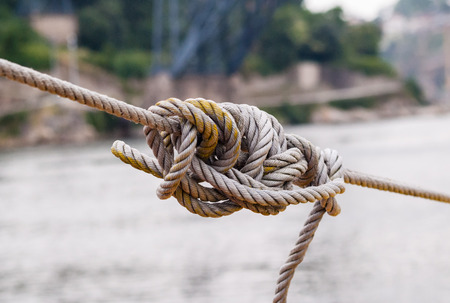 tightened: Tangled knot in tightened rope