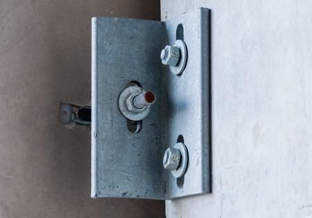 bracket: Metal corner bracket on concrete wall with three screws