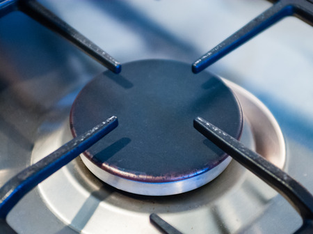 gas stove: Close-up of metallic kitchen stove burner.